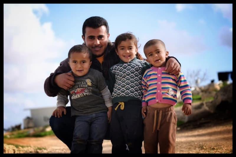 Tariq Hathaleen and the children of Um al-Khair. Photo by Steve Pavey