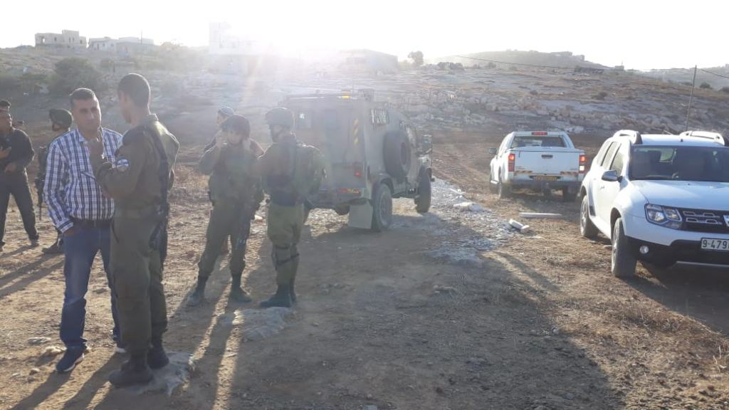 The Israeli military taking a Palestinian cement truck in the South Hebron Hills.